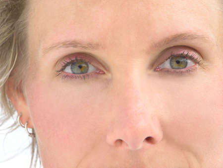 health concern: Close-up Womans eyes with white background Stock Photo