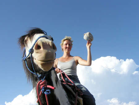 SPanish Mustang and rider saying hi photo