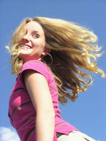 racy: Teen with hair flying and a fun look Stock Photo