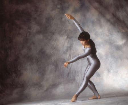 apt: Dancer in silverleotard Stock Photo