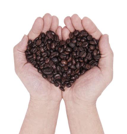分離された白でコーヒー豆の一握り