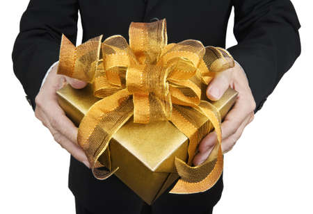 human's arm: A man holding a gift box in a gesture of giving  Isolated on white