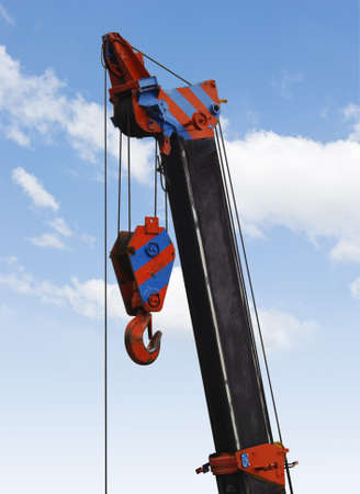heavy industry: Close up a crane hook hanging in midair against the sky Stock Photo