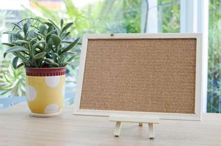 Empty cork board on the table photo