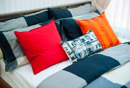 Bed with color pillows Reklamní fotografie