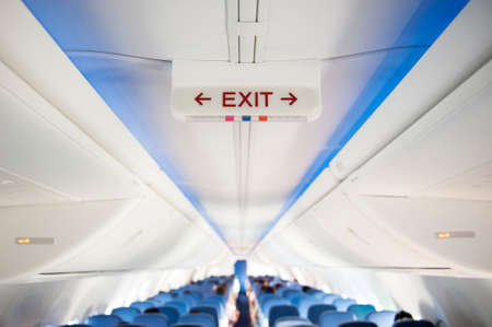 Exit sign in an aircraft interior Stock Photo