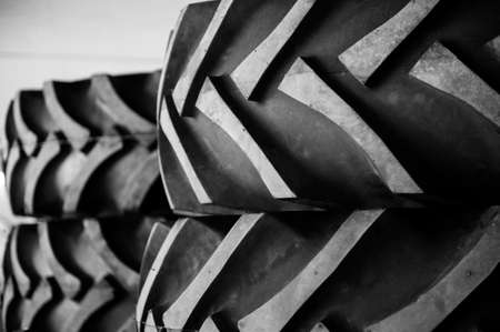 A detail of a row of rubber tractor tires