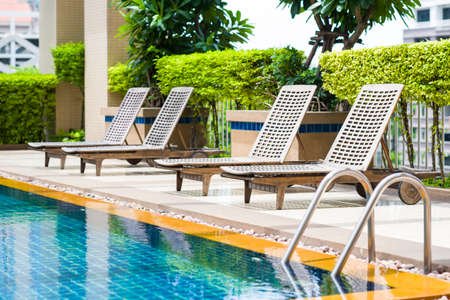 bali province: Modern pool with deck chairs
