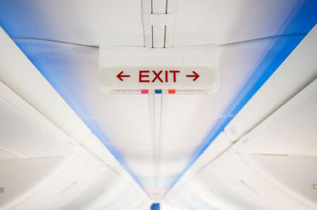 exit sign: Exit sign in modern jet plane Stock Photo