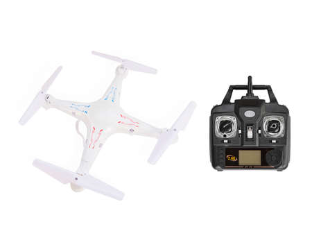 handset: Quadrocopter with radio controlled handset Stock Photo