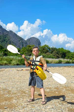 oar: Tourists holding an oar Stock Photo