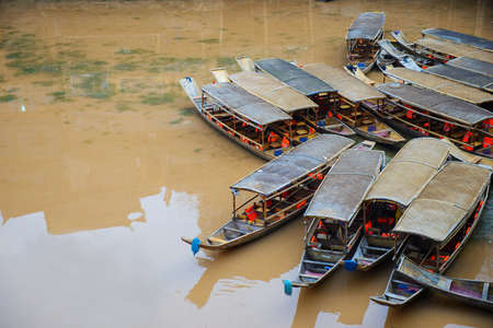 landscape mode: Wooden boat at Fenghuang ancient town, Hunan Province, China