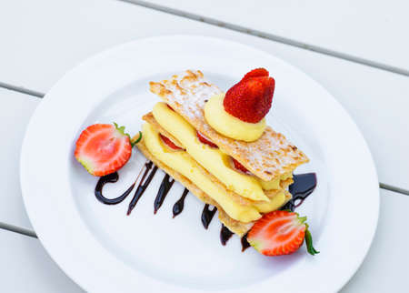 mille: Strawberry mille feuille cake in white plate