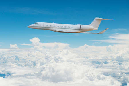 private airplane: Private jet flying on the sky Stock Photo