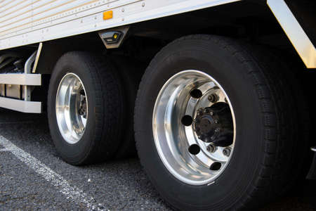 Wheel of large truck and trailers Stock Photo