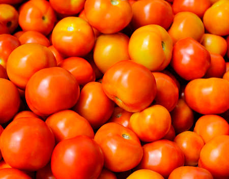 Organically grown red cherry tomatoes background Imagens