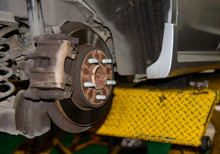 surrogate: Rusty brake disc waiting for maintenance in service garage Stock Photo