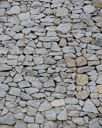 man made structure: Stacked stone wall texture Stock Photo