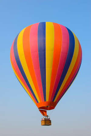 multi race: Colorful hot air balloon against blue sky