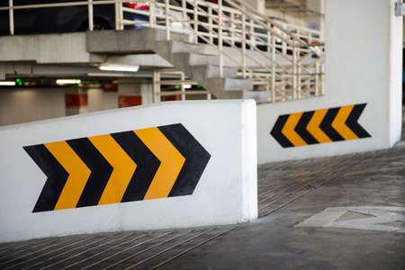 direction sign: Arrows point the way inside of a city parking structure Stock Photo