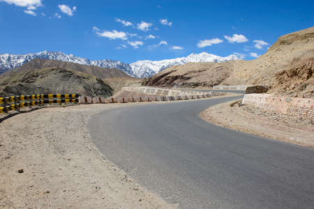 mountain pass: Curved road in high mountain pass in Ladakh