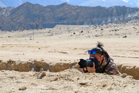 military invasion: Camouflaged photographer