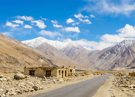 plains indian: Road on plains in Himalayas with mountains Stock Photo
