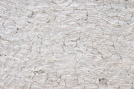 mud wall: Mud wall with large gaping cracks