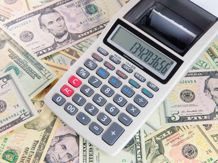 us coin: Financial concept with calculator and dollars background