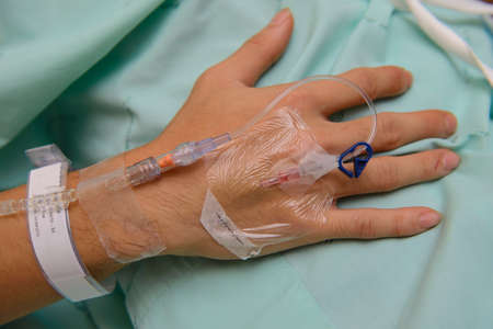 Close up of IV drip in patients hand