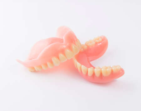 Complete denture on white background