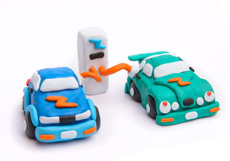 Electric car charging on parking concept with clay Stock Photo