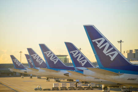 Tokyo, Japan - January 16, 2017 : All Nippon Airlines aircraft parked at Tokyo's Haneda Airport at sunrise on January 16, 2017 Editorial