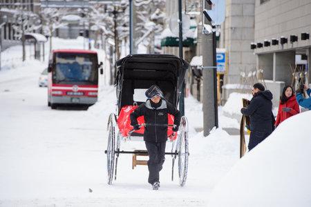 Sapporo, Japan - January 15, 2017 : Japanese traditional rickshaw called Jinrikisha for tourists in Otaru, Sapporo Editorial