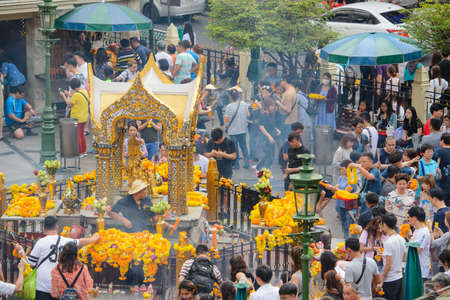 Bangkok, Thailand - January 27, 2018 : People are paying respect to the Erawan Shrine, which is a Hindu shrine housing a statue of Phra Phrom, the Thai representation of the Hindu creation God Brahma