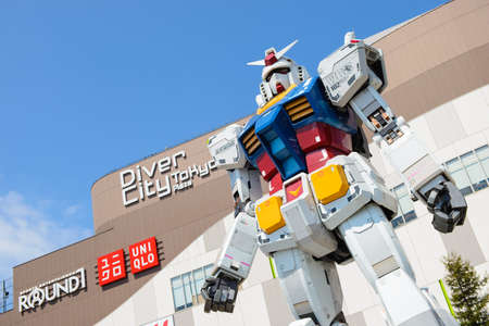 Tokyo, Japan - April 2, 2015 : Statue of Gundam in front of the diver City Plaza in Odaiba