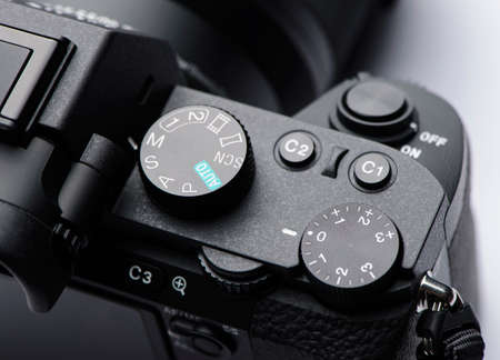 Mode dial, exposure control dial and shutter button on mirrorless camera