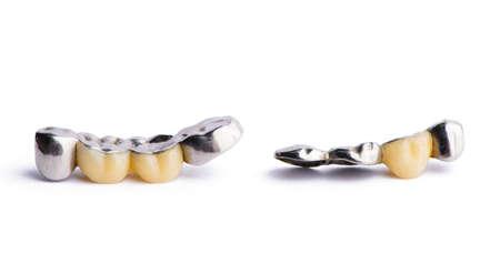 Ceramic dentures. Isolated on white background. Stock Photo
