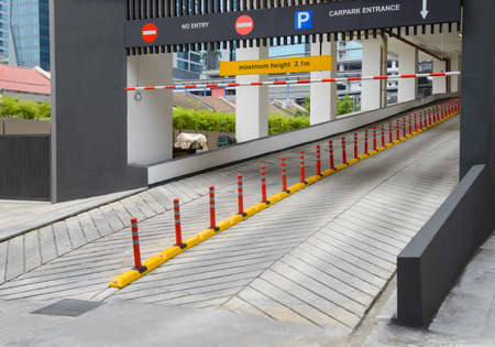 Entrance to car park ramp slope way on front of building
