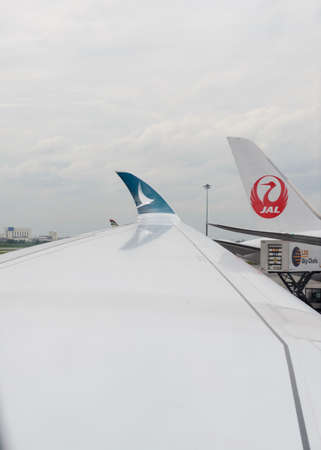 Bangkok, Thailand - August 16, 2018 : Cathay Pacific Airbus 350-900 winglet with JAL airline on background at Bangkok International Airport