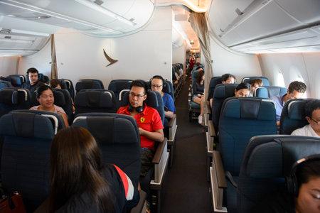 Singapore, Singapore - August 16, 2018 : Inside the premium economy class in flight of Cathay Pacific Airbus 350-900XWB