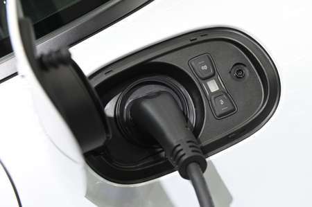 Electric car charging process by power cable supply plugged in
