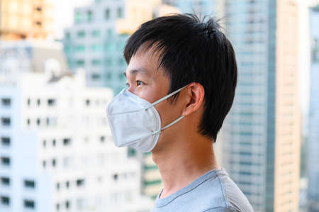 Asian man wear mask for air pollution