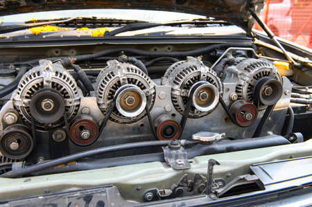 Four alternator for the car attached on engine
