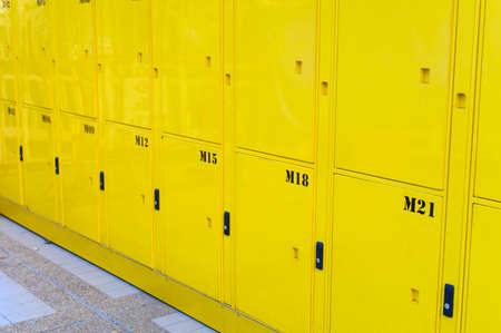 Close up on yellow lockers door at public locker service Reklamní fotografie