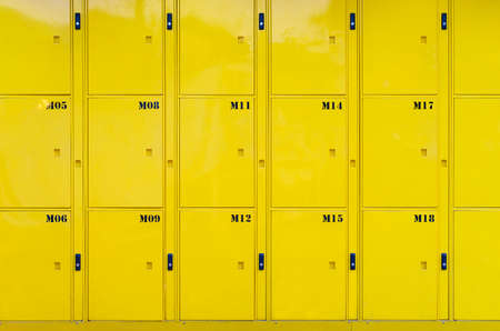 Stack of yellow lockers door at public locker service