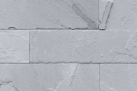 Grey stone wall as a background or texture Stock Photo