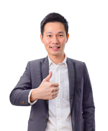 Smiling asian businessman with thumb up Imagens