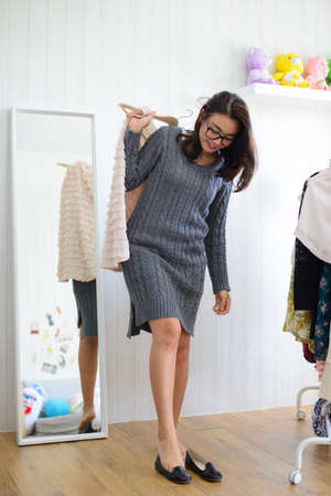Young asian woman trying on shoes in dressing room