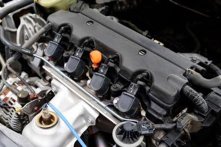 Close up detail of spark plug on car engine